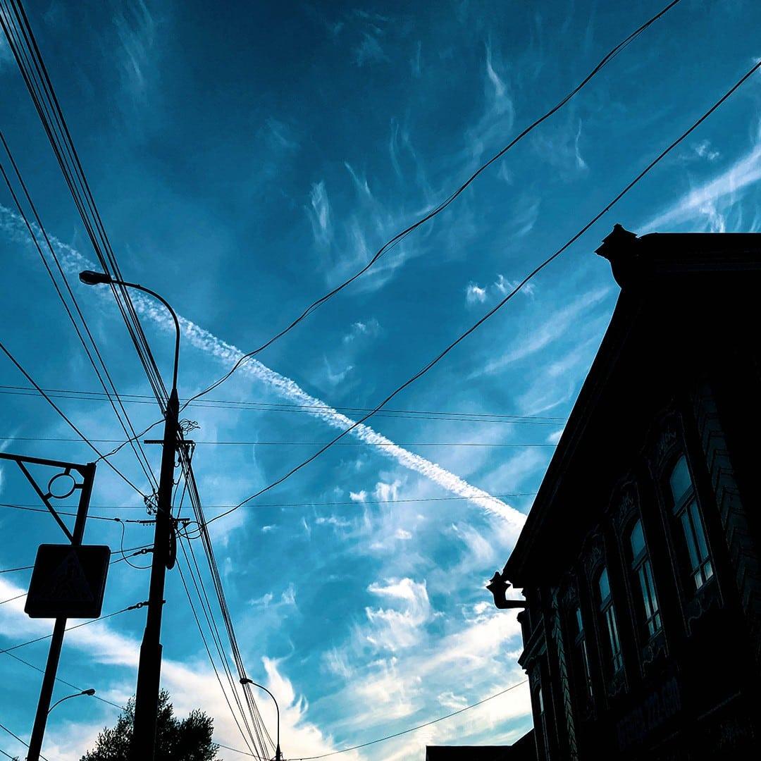 Aeroplane trails over houses